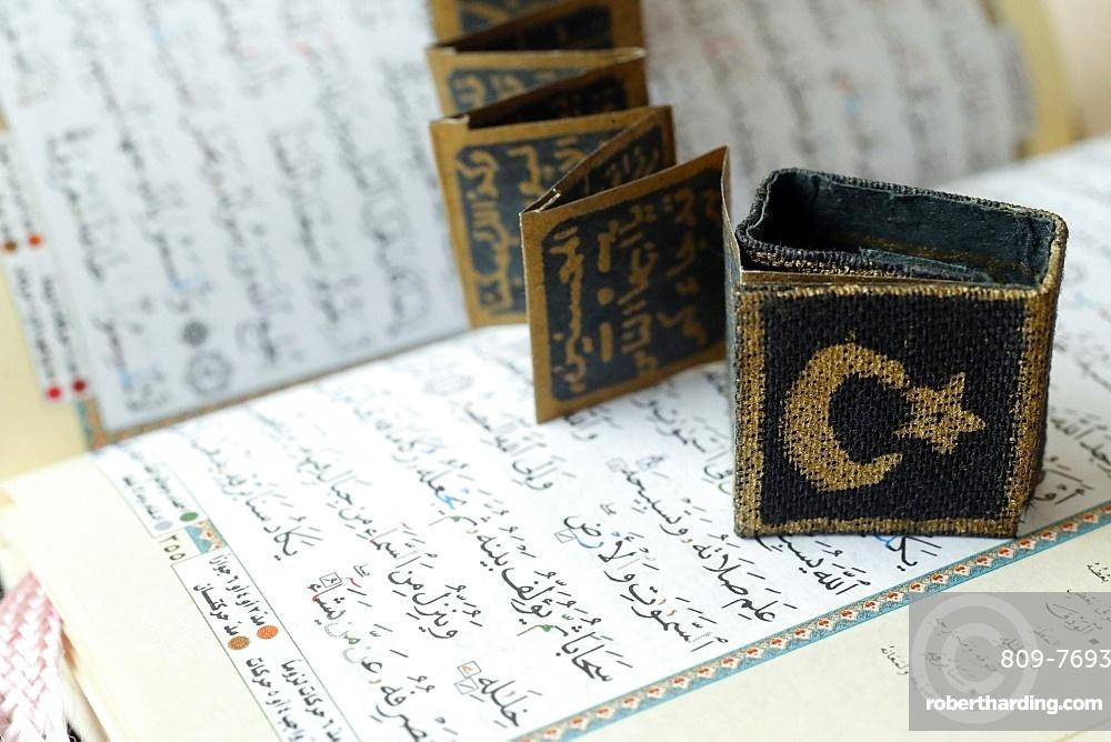 Close-up of Quran, crescent, star and surats, Muslim symbols, Vietnam, Indochina, Southeast Asia, Asia
