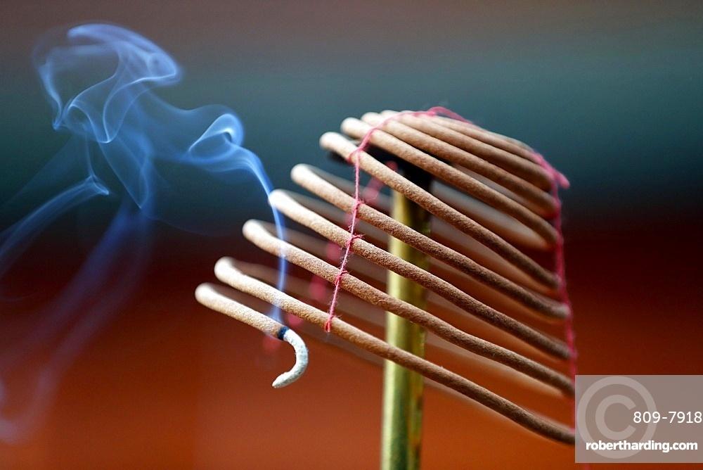 Burning spiral incense sticks in Taoist ceremony, Mau Son Taoist temple, Sapa, Vietnam, Indochina, Southeast Asia, Asia