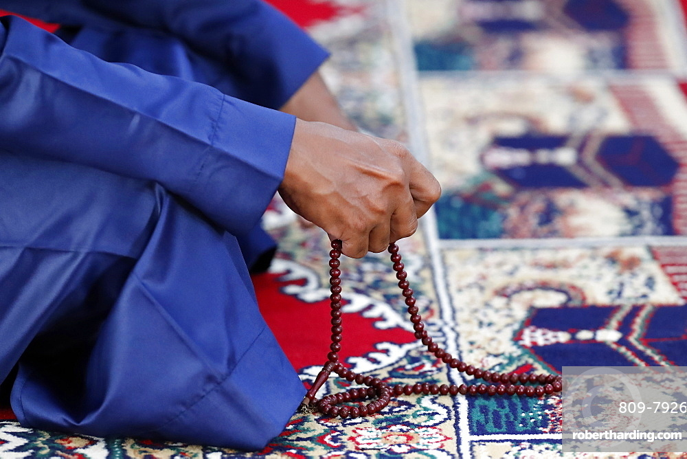Muslim praying with Tasbih (prayer beads), Ho Chi Minh City, Vietnam, Indochina, Southeast Asia, Asia