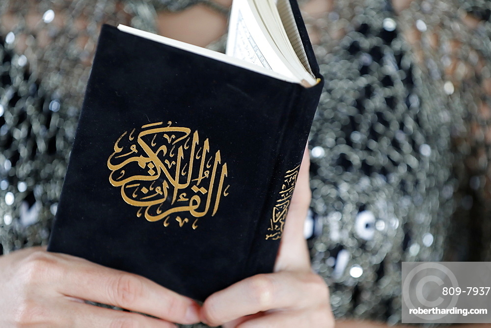 Close-up of woman reading the Noble Quran, Ho Chi Minh City, Vietnam, Indochina, Southeast Asia, Asia