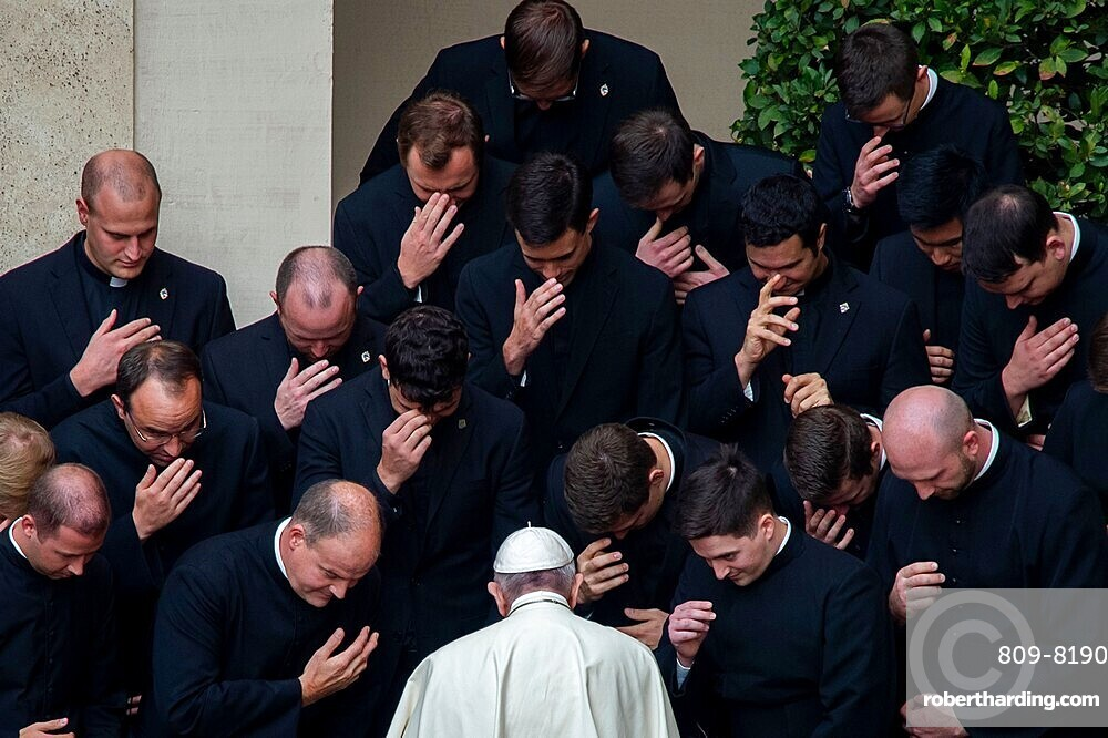 Pope Francis prays with priests at the end of a limited public audience at the San Damaso courtyard in The Vatican, Rome, Lazio, Italy, Europe