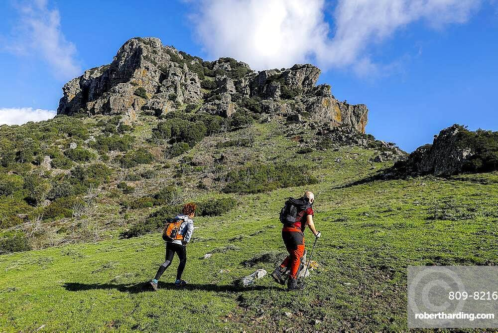 Trekkers on Arcuentu mountain, Sardinia, Italy, Europe