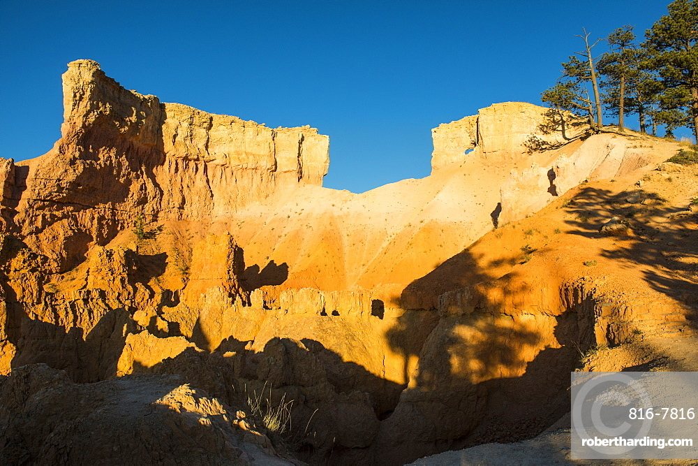 Early sunrays shining on the pinnacles of the Bryce Canyon National Park, Utah, United States of America, North America