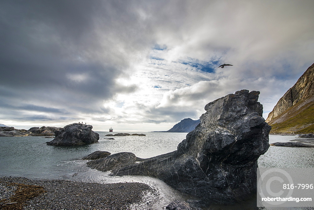 Expedition ship looking through the rocks of Alkhornet, Svalbard, Arctic