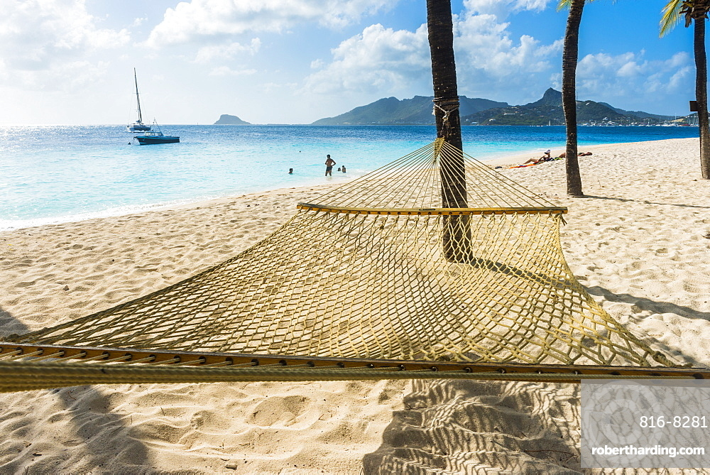 Hammock between two palms on a sandy beach, Palm Island, The Grenadines, St. Vincent and the Grenadines, Windward Islands, West Indies, Caribbean, Central America