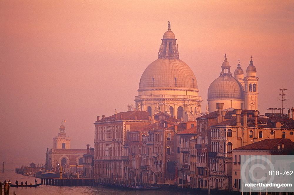 The Grand Canal with Santa Maria della Salute at dusk, Venice, UNESCO World Heritage Site, Veneto, Italy, Europe