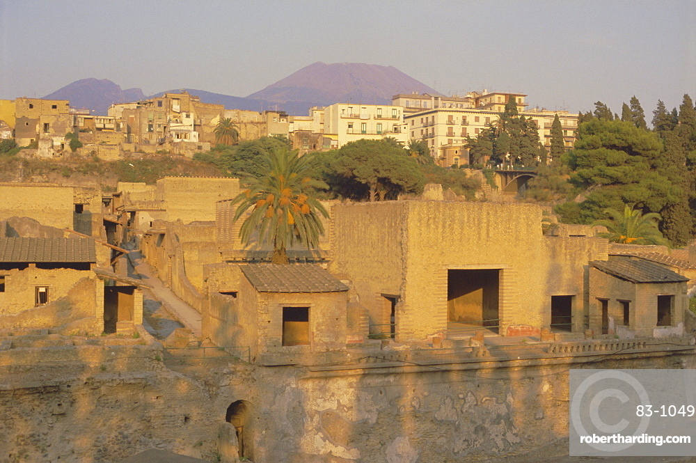 Mount Vesuvius behind the ruins of the Roman resort of Herculaneum, destroyed in the eruption of AD 79 which covered the town in lava and mud, Herculaneum, near Naples, Campania, Italy, Europe