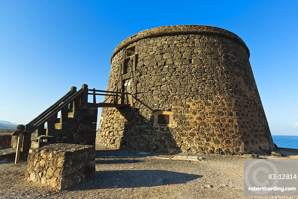 Old tower (toston), a defence against English pirates at this northwest coast village, El Cotillo, Fuerteventura, Canary Islands, Spain, Europe