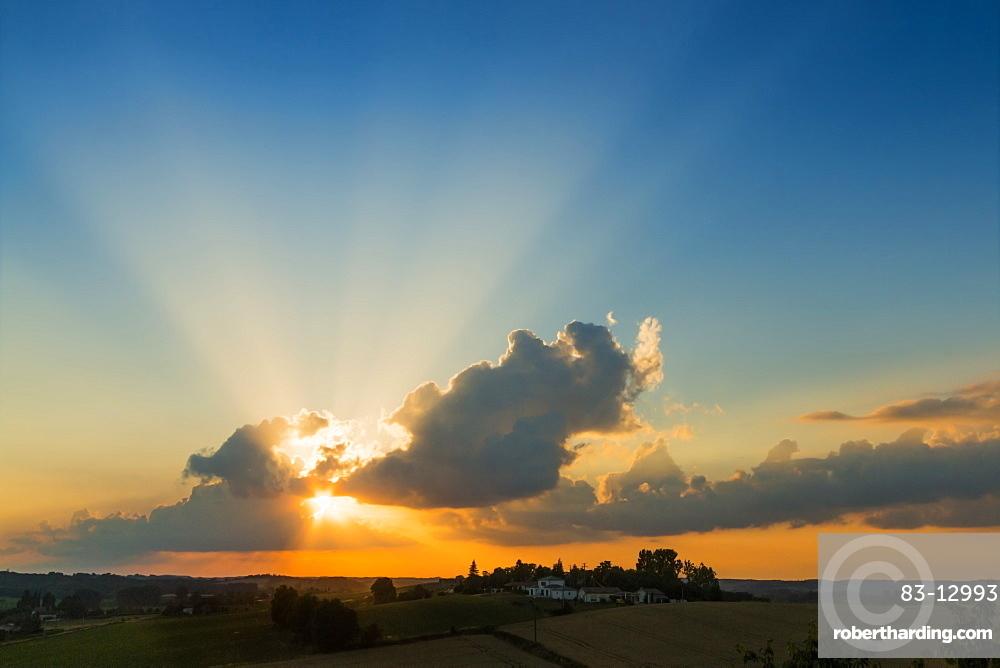 View westwards at sunset from this quiet hilltop village near Duras, Levignac-de-Guyenne, Lot-et-Garonne, Aquitaine, France, Europe