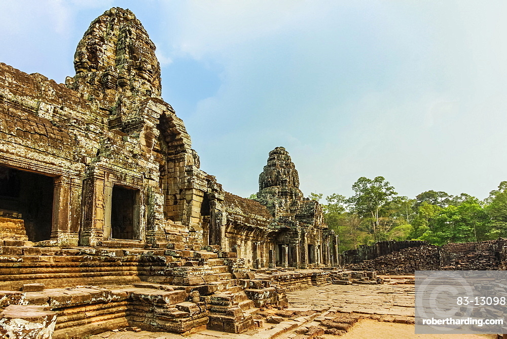 West inner gallery towers and four of the 216 carved faces at Bayon temple in Angkor Thom walled city, Angkor, UNESCO World Heritage Site, Siem Reap, Cambodia, Indochina, Southeast Asia, Asia