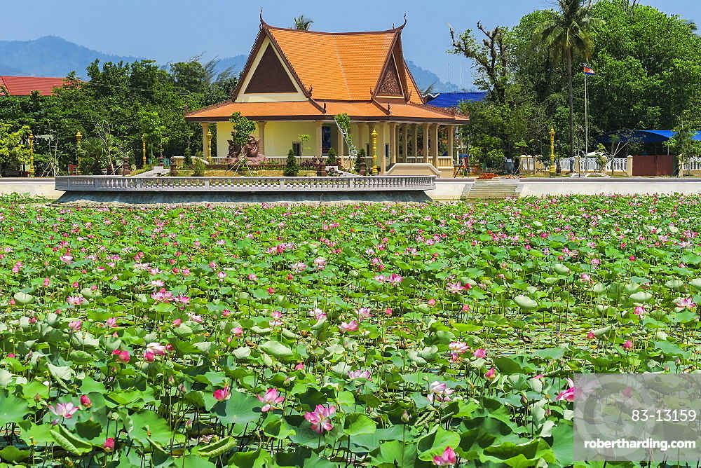 Ornamental lake covered with lily pads by temple pavilion at this quiet former French resort town, Kep, Kep Province, Cambodia, Indochina, Southeast Asia, Asia