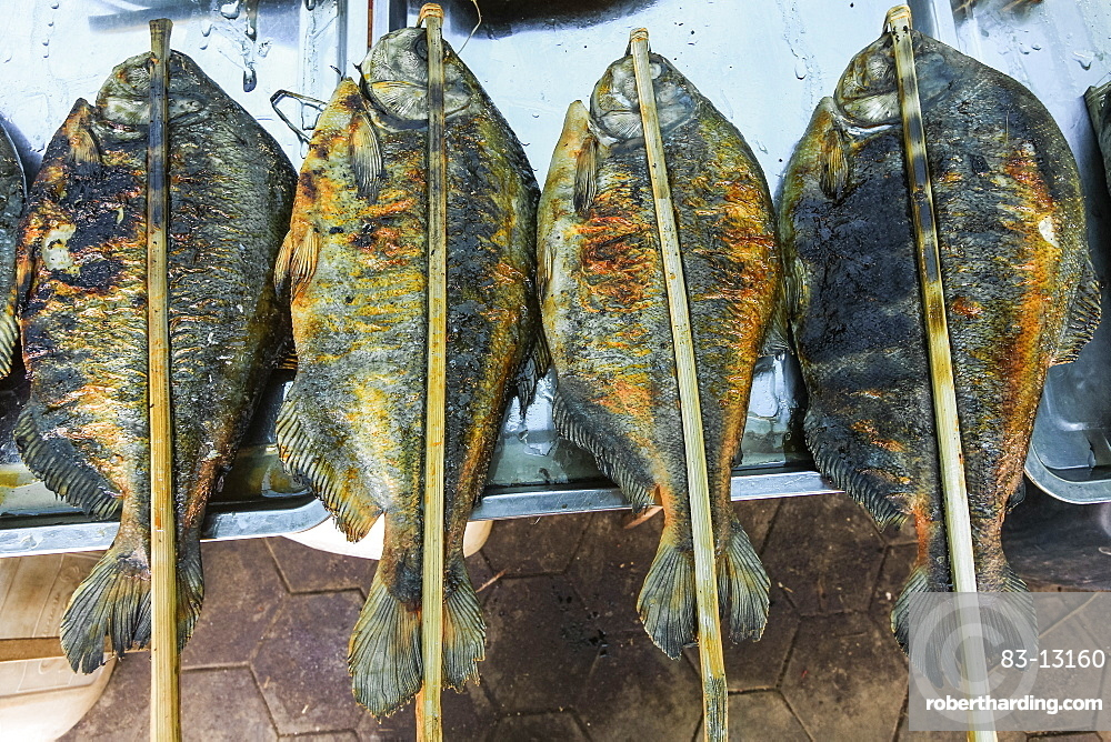 Fish barbecued with sticks at a stall in the Crab Market in this resort town famous, for it's seafood, Kep, Cambodia