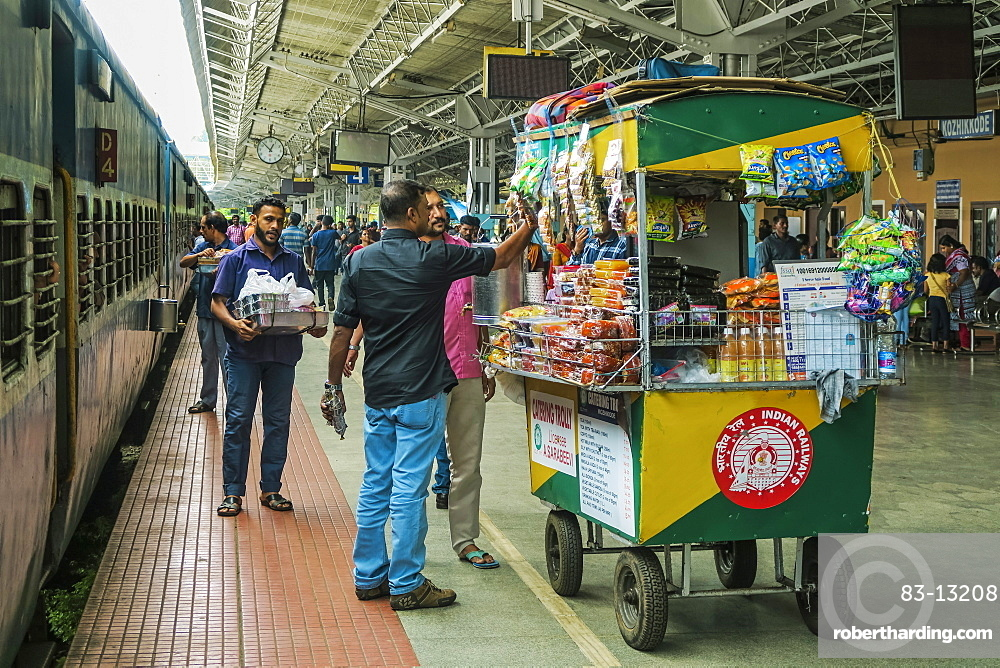 Catering snack trolley at railway station of Khozikode (Calicut), second largest city in the state, Khozikode, Kerala, India, Asia