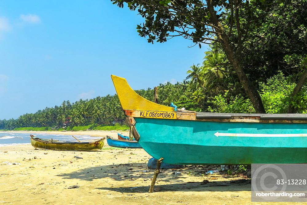 Fishing boats at lovely unspoilt, Kizhunna Beach, south of Kannur on the Keralan north coast,Kizhunna, Kannur, Kerala, India, Asia