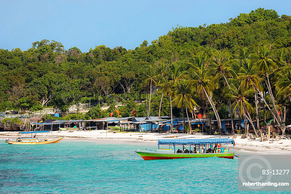 Tourist dive boat moored by white sand Bira Beach at far South resort town, Tanjung Bira, South Sulawesi, Indonesia, Southeast Asia, Asia