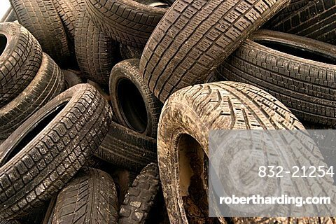 Old motor-car tires on a garbage depot