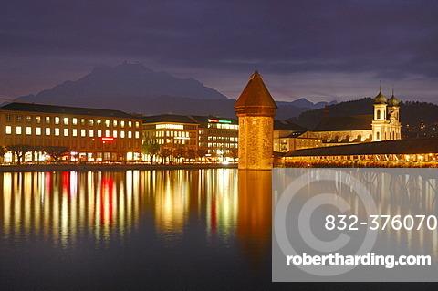 Kapellbruecke mit water tower at dusk, Lucerne, Switzerland