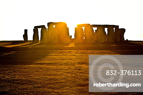 Stonehenge in front of the setting sun, Wessex, England, Great Britain, Europe