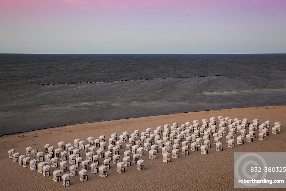 White beach chairs on the beach at twilight, Baltic Seaside Resort Sellin, Rügen, Mecklenburg-Western Pomerania, Germany, Europe