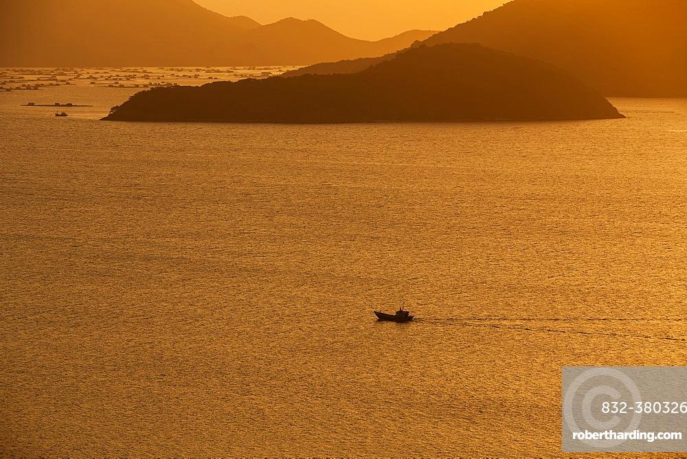 Fishing boat at sea, sunset, Nha Trang Bay, Hong Ong Island, South China Sea, Vietnam, Asia