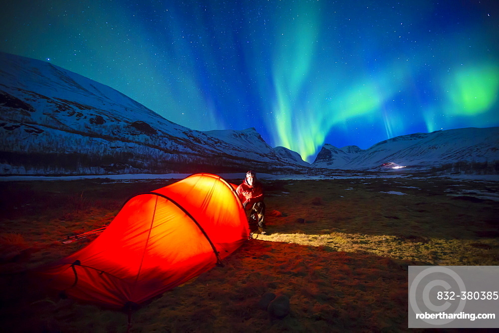 Northern Lights (Aurora borealis) over a tent in winter, Kungsleden or Königsweg, Province of Lapland, Sweden, Europe