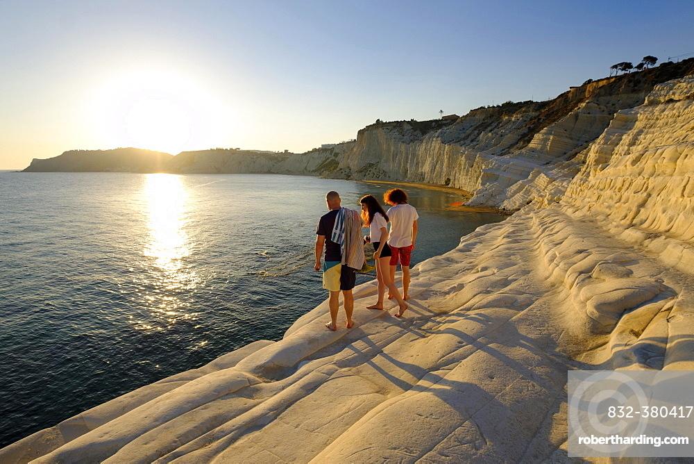 Tourists during sunset, rocky coast of Scala dei Turchi, limestone rocks, Realmonte, Province of Agrigento, Sicily, Italy, Europe