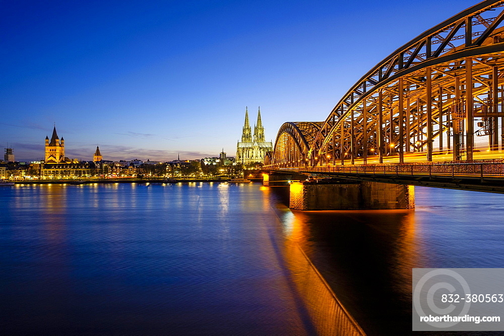 Church St Martins and Cologne Cathedral with Hohenzollern Bridge over the Rhine, Dusk, Cologne, North Rhine-Westphalia, Germany, Europe