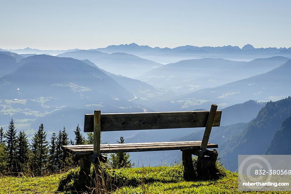 Wooden bench overlooking Schladming Tauern, Alps, Styria, Austria, Europe