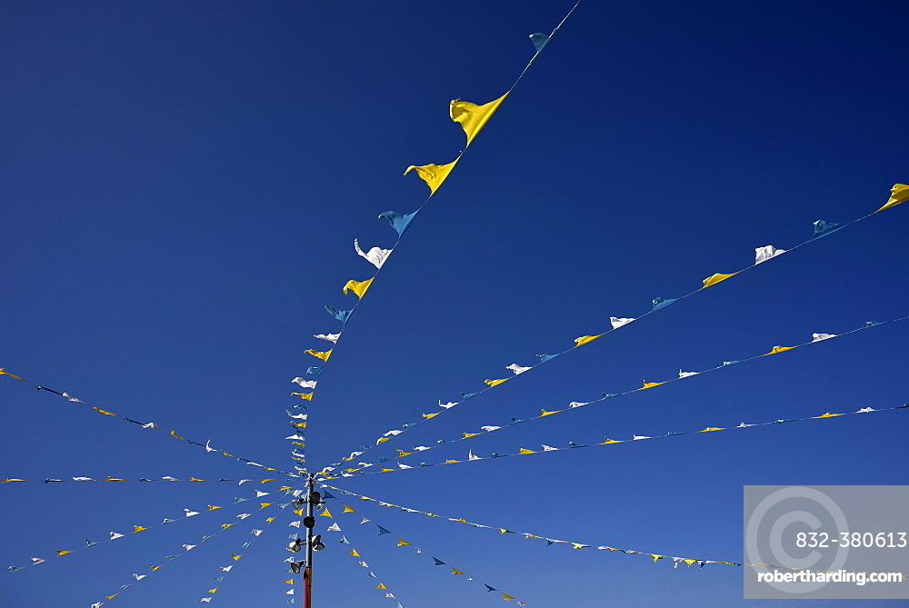 Colorful pennant against a blue sky at a festival, Candelaria, Tenerife, Canary Islands, Spain, Europe