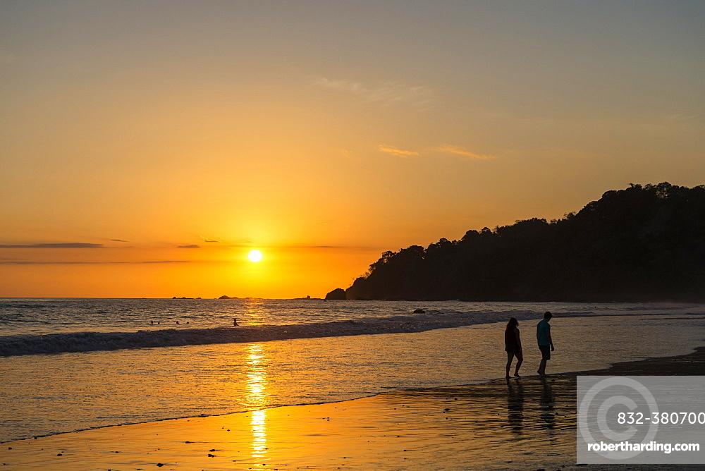 Man and woman strolling on the beach, sunset, Playa Espadilla, Manuel Antonio National Park, Costa Rica, Central America