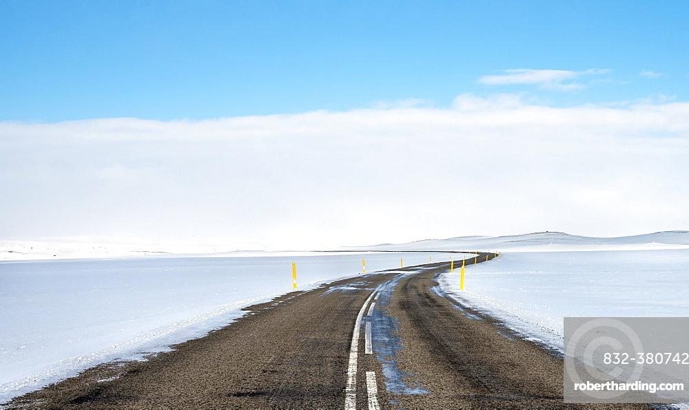 Road through snowy landscape, Route 1 between Eglstadir and Myvatn, Norourland eystra, Northern Iceland, Iceland, Europe