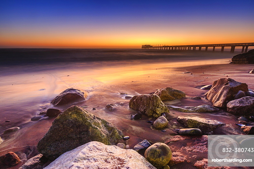 Beach at a former pier, jetty at sunset, Atlantic, Swakopmund, Erongo Region, Namibia, Africa