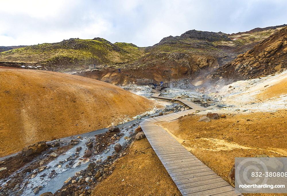 Boardwalk over steaming ground, mineral deposits, Seltun geothermal area, Krysuvik volcanic system, Reykjanesfolkvangur conservation area, Iceland, Europe