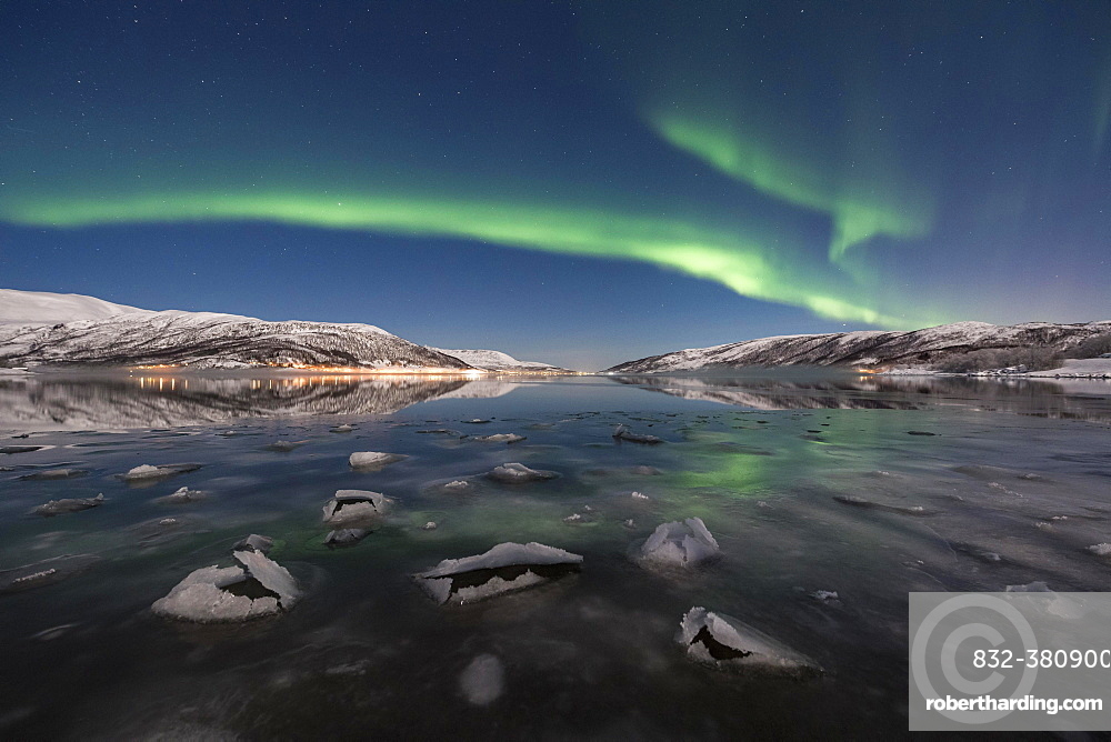 Northern lights over fjord with ice floes, island of Senja, Troms, Norway, Europe