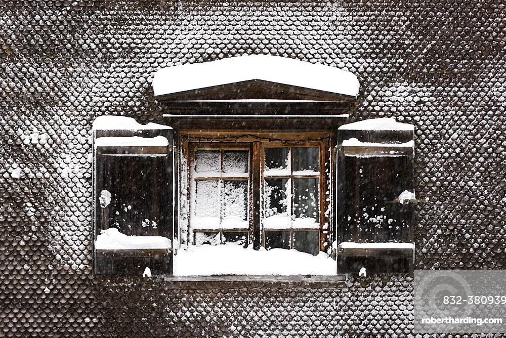 Snow-covered window on old farmhouse, Hittisau, Bregenz Forest, Vorarlberg, Austria, Europe