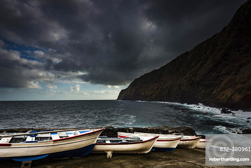 Rowing boats on the shore with dramatic clouds and sea, Nordeste, Sao Miguel, Azores, Portugal, Europe