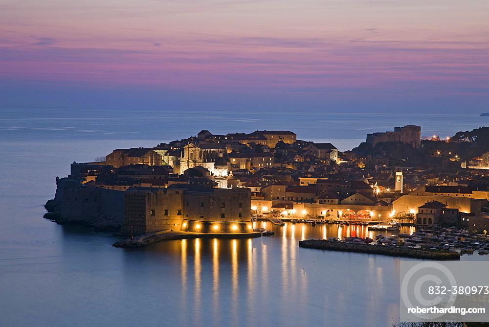 Panoramic view of the illuminated old town, dusk, Dubrovnik, Croatia, Europe