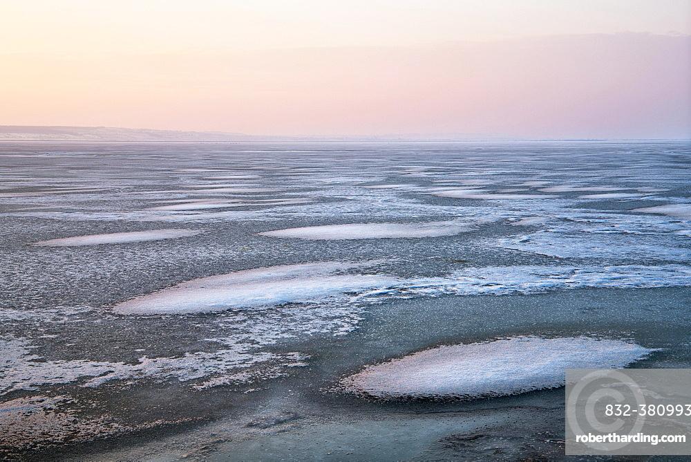 Evening atmosphere at the frozen Lake Neusiedl, near Illmitz, Seewinkel, Burgenland, Austria, Europe