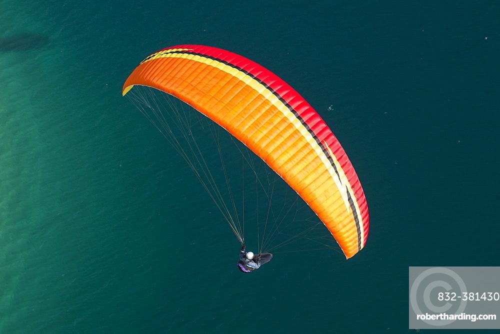 Paragliding over Molveno Lake, Trentino Province, Italy, Europe