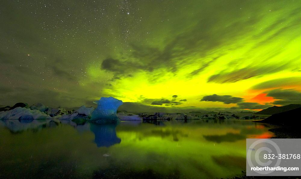 Blue iceberg in Aurora Borealis, Jökulsárlón, Hornafjörður, Austurland, Iceland, Europe
