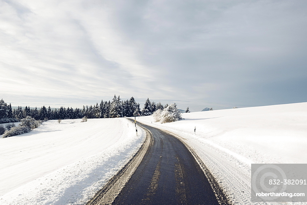 Cleared country road in winter landscape, Baden-Wurttemberg, Germany, Europe