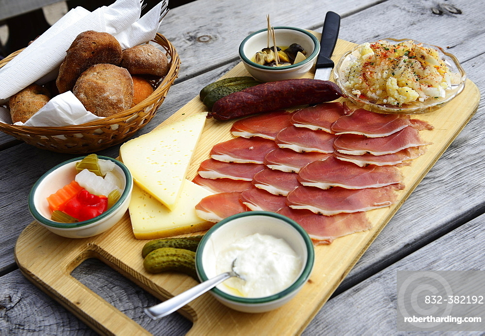 Snack plate with bacon, salami, gray cheese and horseradish on the Rossalm, Braies, Sexten Dolomites, South Tyrol, Italy, Europe