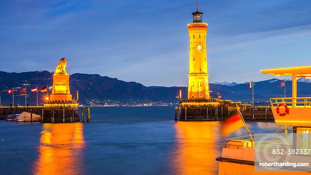 Harbor with Lighthouse and Bavarian Lion at dusk, Lindau, Lake Constance, Bavaria, Germany, Europe