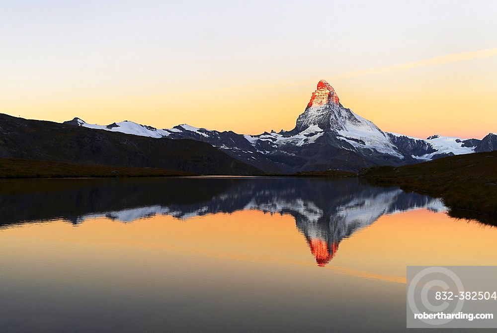 Matterhorn reflected in lake Stellisee, at sunrise, Valais Alps, Canton of Valais, Zermatt, Switzerland, Europe