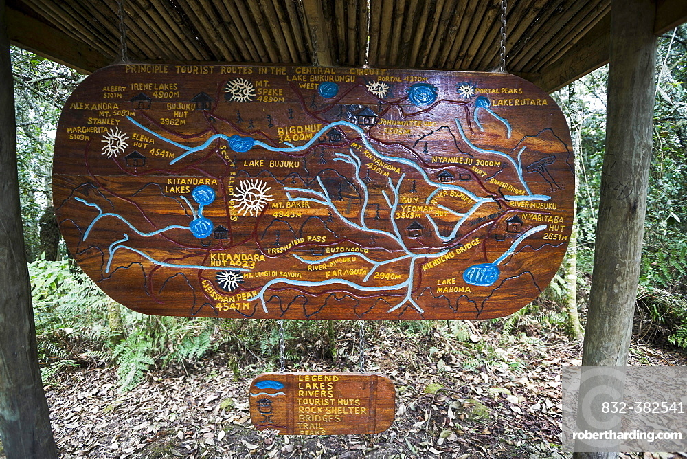 Wooden sign depicting hiking trails of the Central Circuit, Rwenzori Mountains, Uganda, Africa