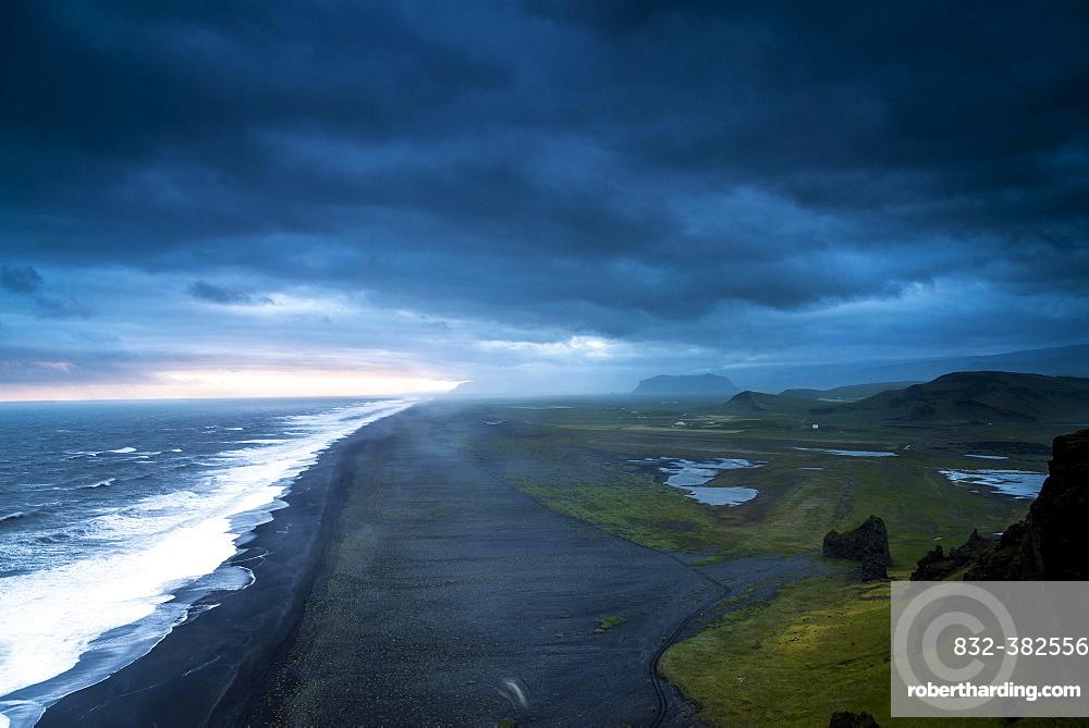 Dramatic clouds, black sandy beach near Dyrholaey, south coast, Southern Region, Iceland, Europe