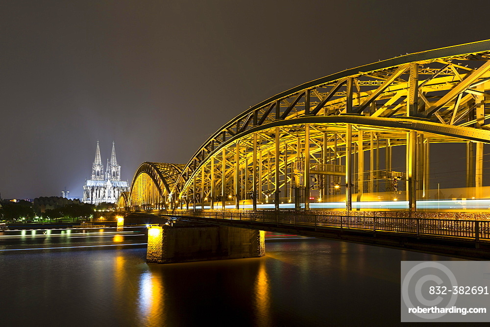 The illuminated Cologne Cathedral and Hohenzollern Bridge at night with Rhine, Deutz, Cologne, North Rhine-Westphalia, Germany, Europe