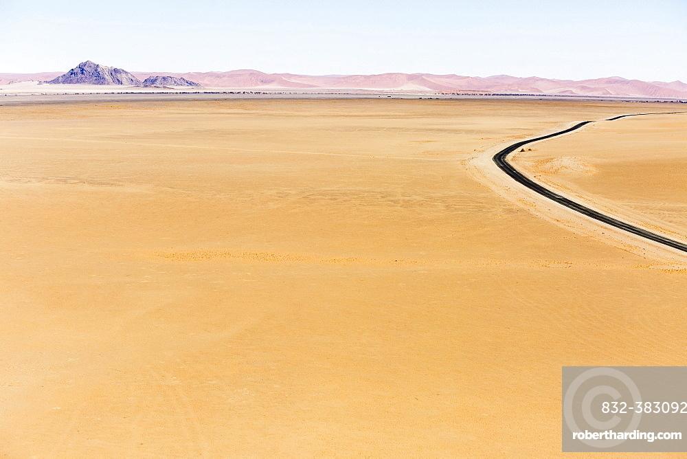Aerial view, tarred road pulling you through desert landscape, Sossusvlei, Namib Desert, Namib-Naukluft National Park, Namibia, Africa