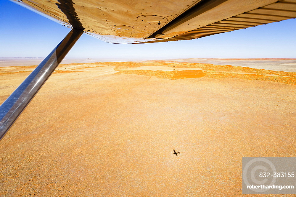 Aerial view, shadow of small aircraft on the ground, Namib Desert, Namib-Naukluft National Park, Namibia, Africa