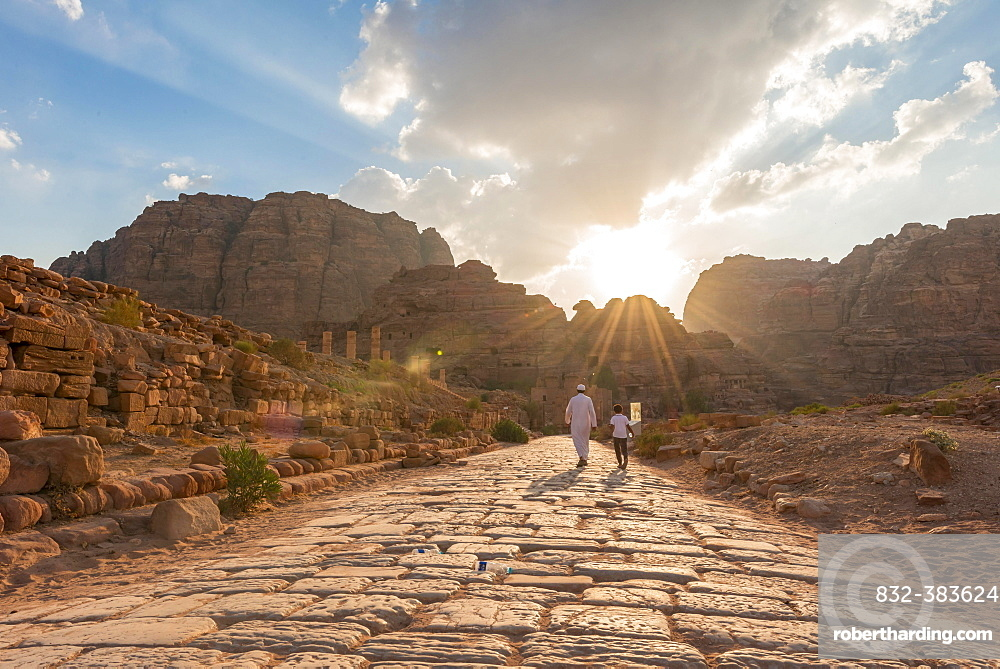 Two locals walk on Old Roman Road next to ruins of Petra, Nabataean city of Petra, near Wadi Musa, Jordan, Asia